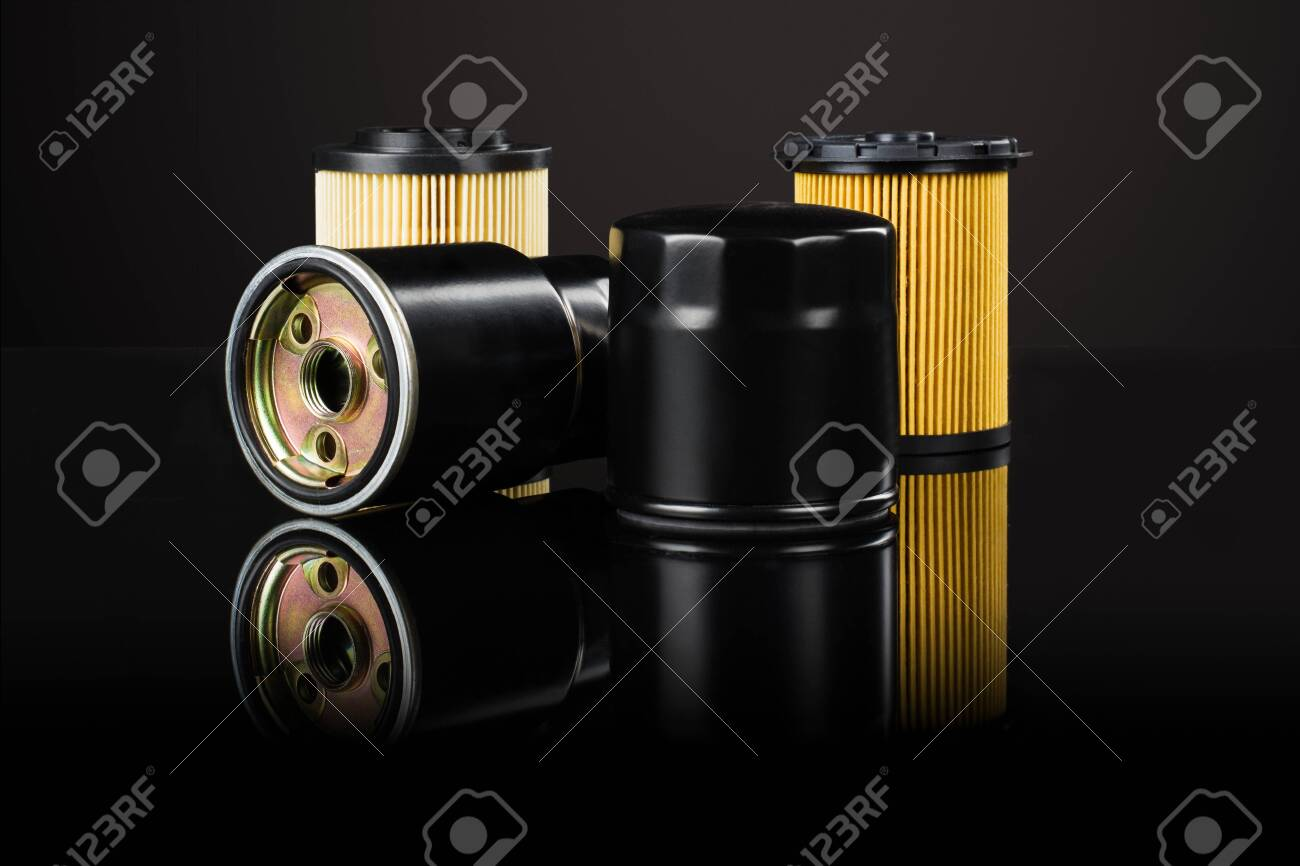 Various car or automotive parts on black background with reflection and copy space around products - 139229983