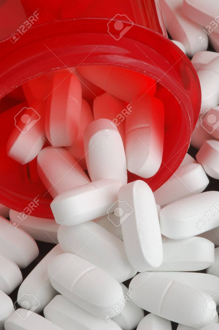 Prescription bottle with white tablets Stock Photo - 4964622