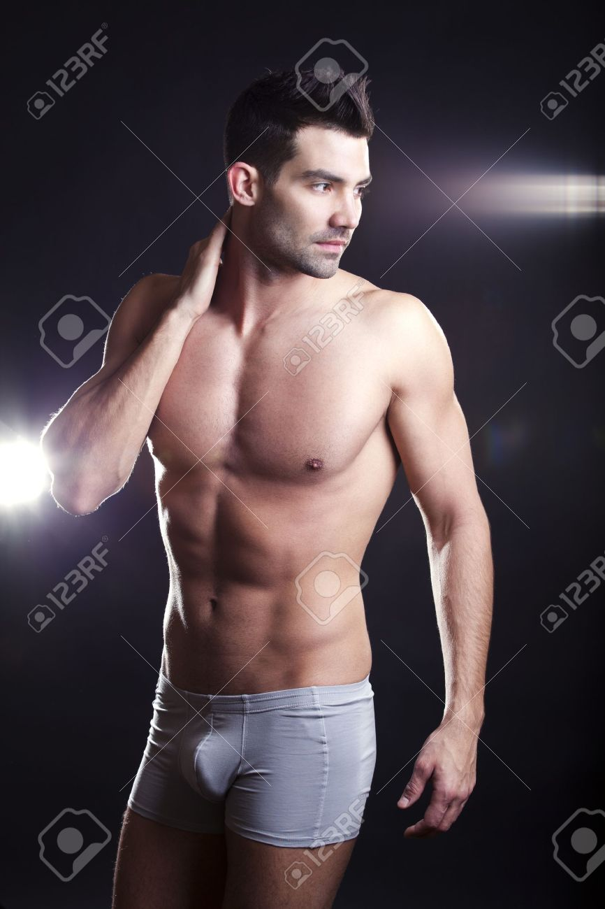 Closeup of a muscular handsome man in underwear Stock Photo - 9166299