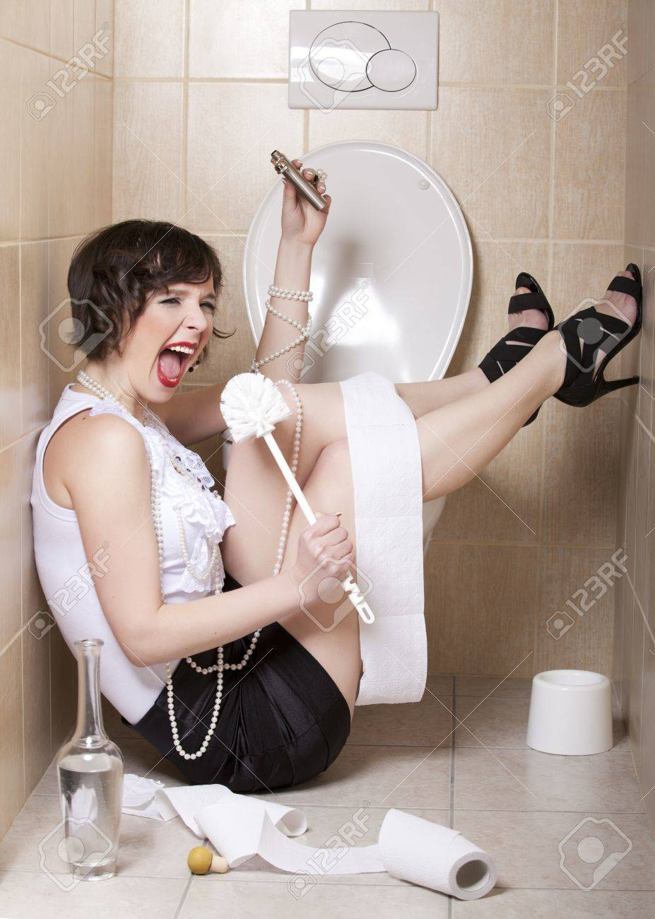 Drunk woman sitting dizzy on the toilet floor Stock Photo - 9166408
