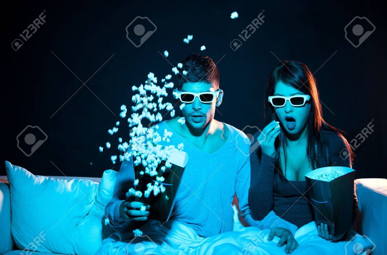 Love couple in 3D glasses at home Stock Photo - 11341969