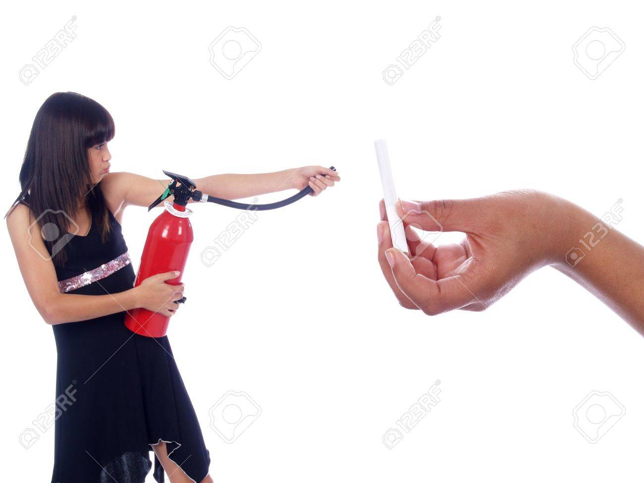 young girl killing cigarette with fire extinguisher Stock Photo - 2032411