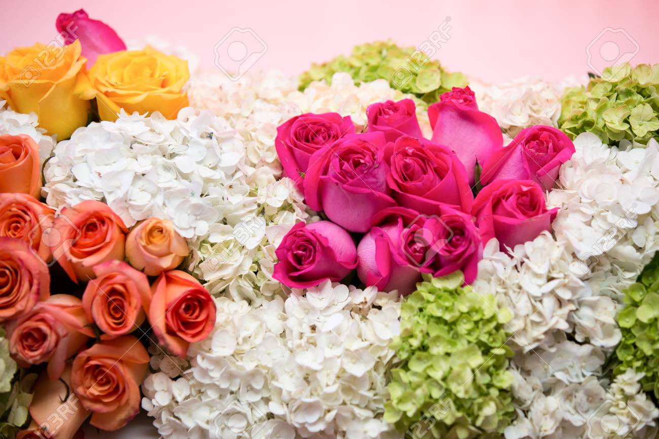 Bunch Of Colorful Flowers Pink Yellow And Orange Roses With