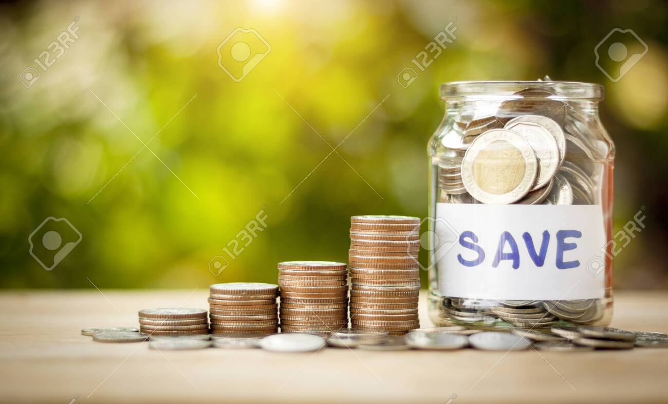 Coins in a jar to show saving money, investment and business with money coins stack for growing with natural - 154411551