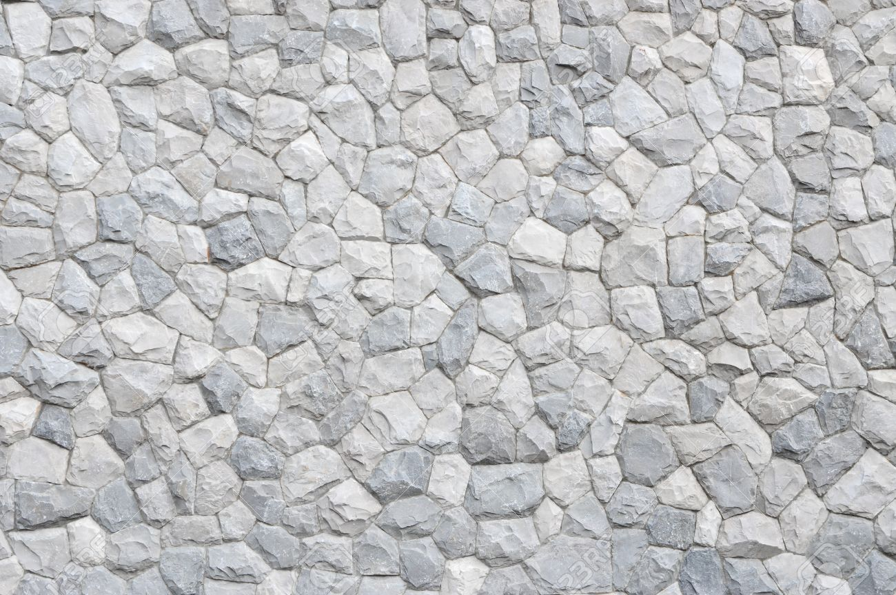 Rock Wall Background. Rough Stone Texture. Stock Photo, Picture And ...