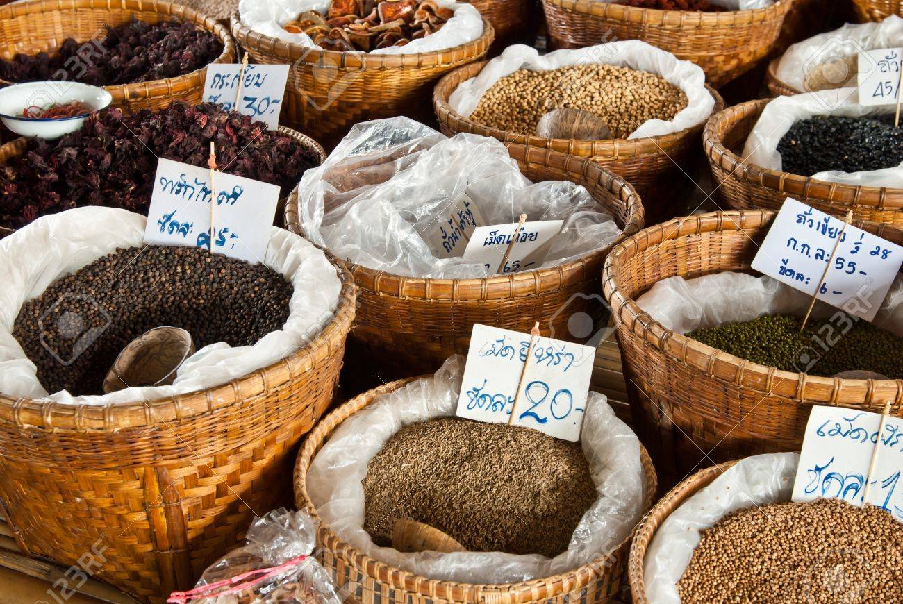 Spices and herbs in bamboo basket at market Stock Photo - 9646804