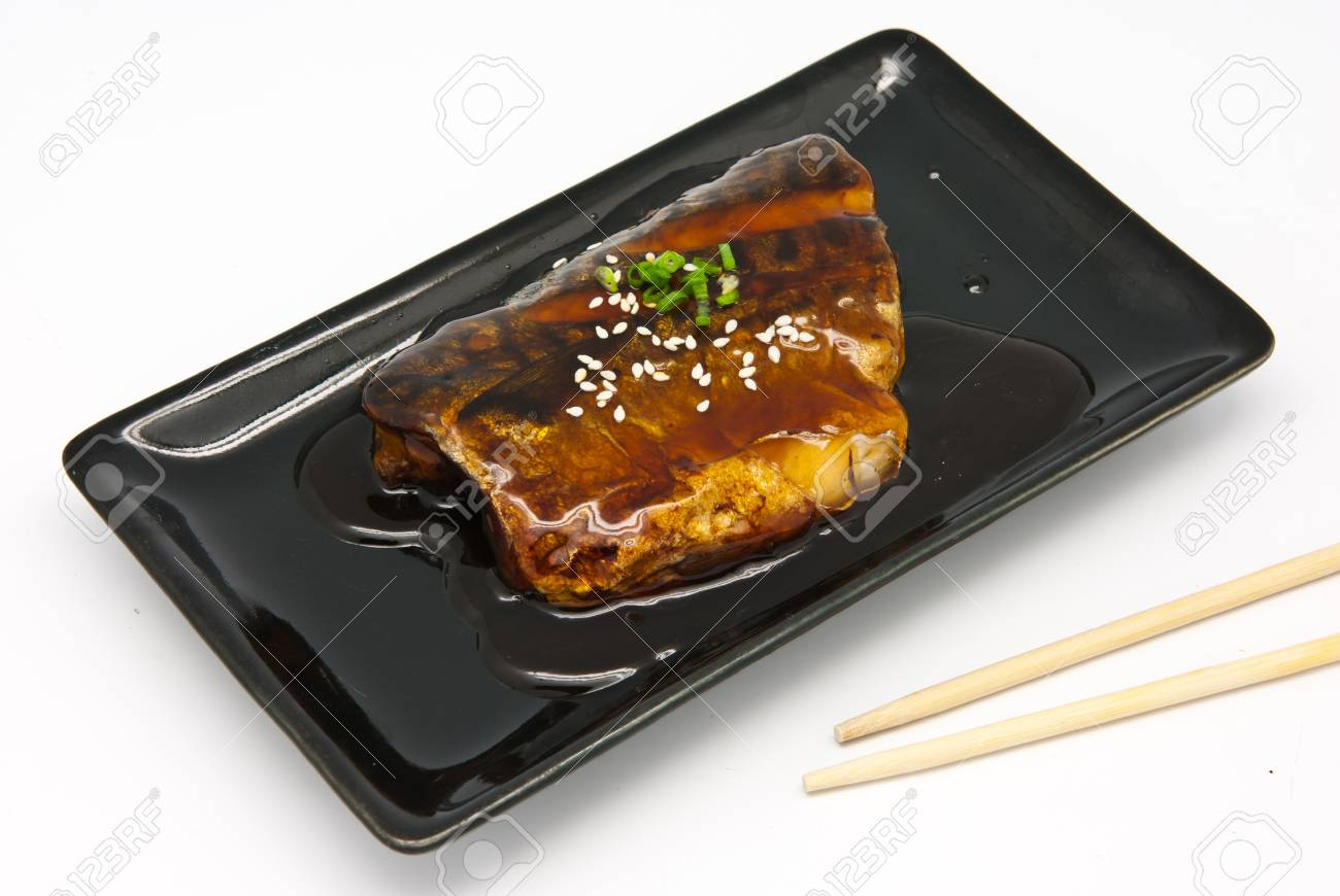 Japanese food style , Saba fish grilled with sauce in  the plate on white background Stock Photo - 9731164