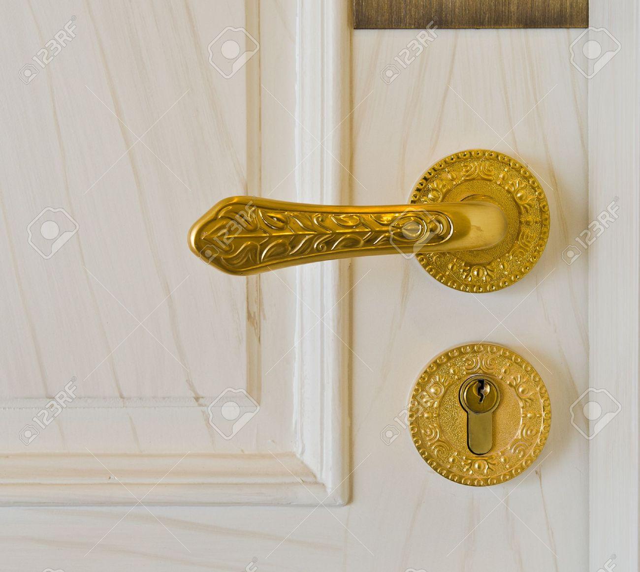 golden door handle and deadbolt on wooden door Stock Photo - 10993821 & Golden Door Handle And Deadbolt On Wooden Door Stock Photo ... Pezcame.Com
