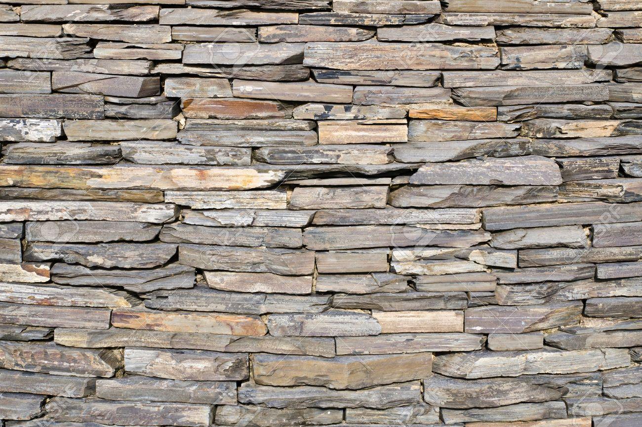 Decorative Stone Wall pattern of decorative slate stone wall surface stock photo