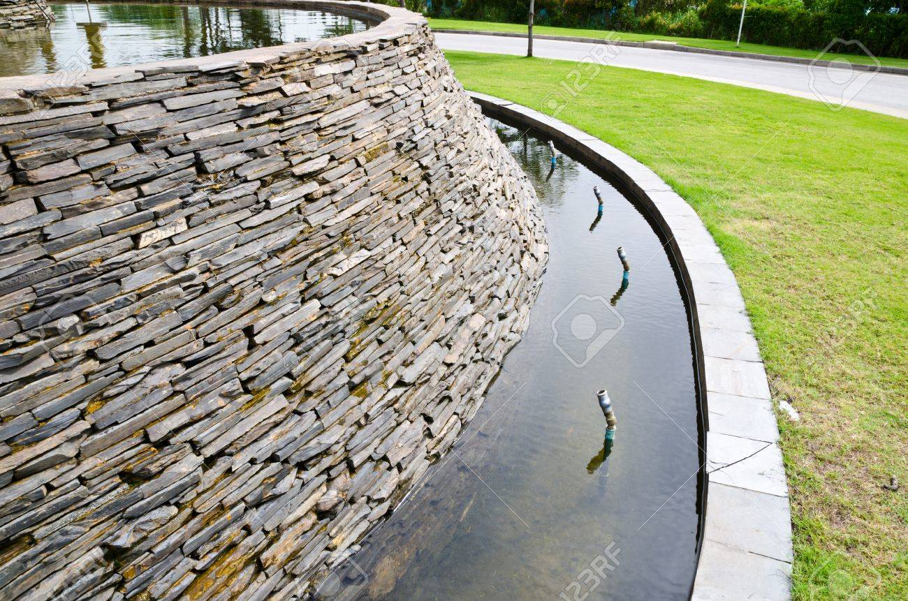 decorative fountain wall with a slate stone in the garden stock