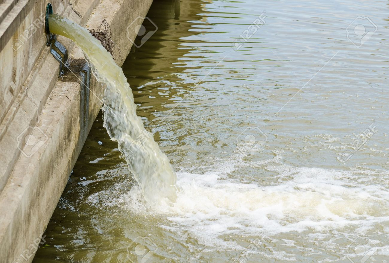 Photo of flow out water from the conduit of Industrial factory to the river Stock Photo - 15629589