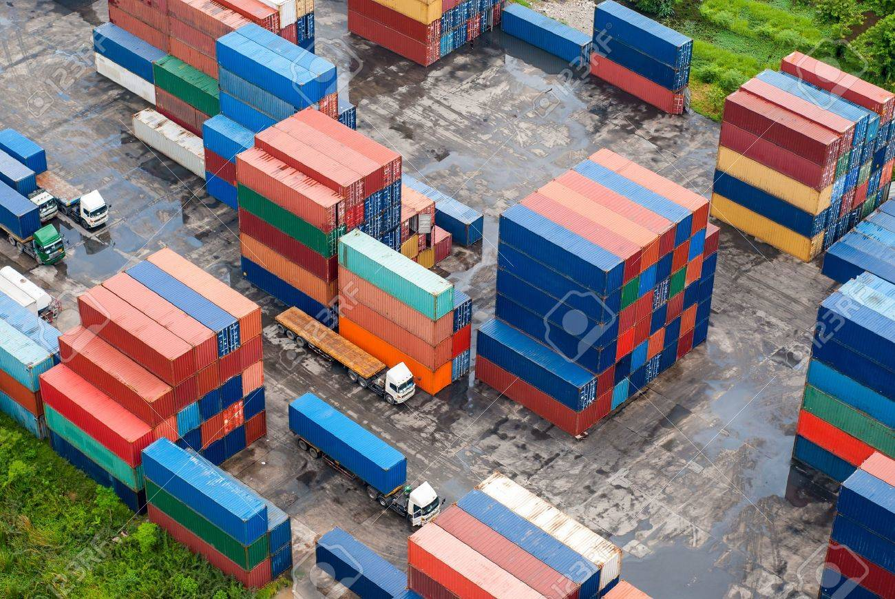 Stack of Freight Containers at the Docks with Truck Stock Photo - 17080969