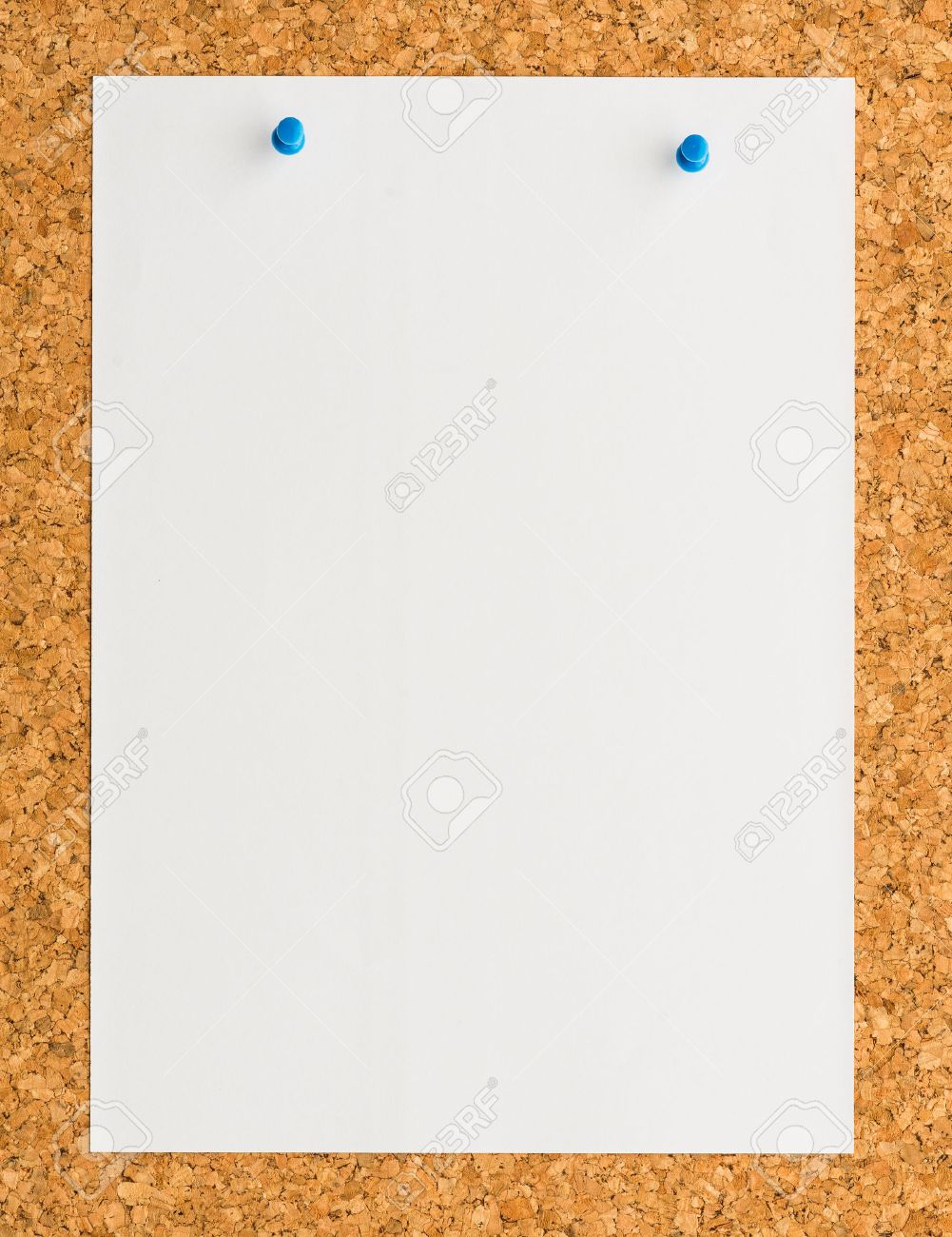 close up blank white paper note sheet blue push pin on cork stock photo close up blank white paper note sheet blue push pin on cork board background for write memo