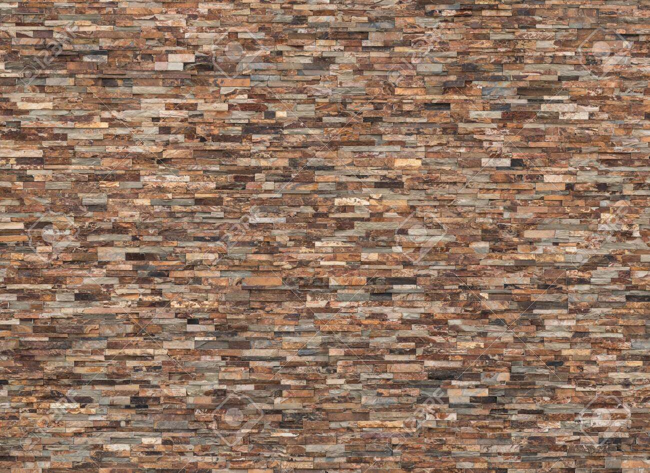 background and texture of vintage real slate stone wall - 131129476