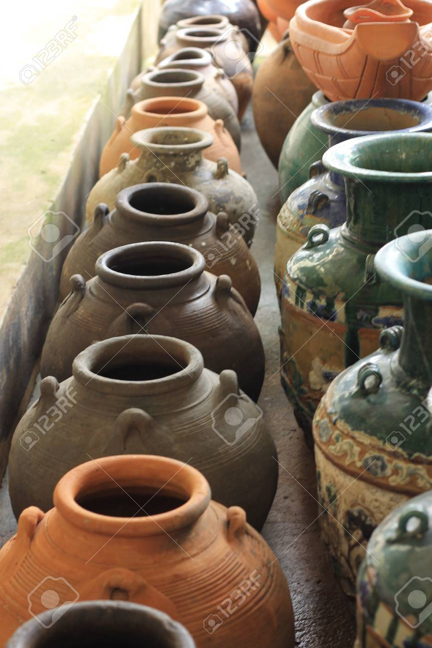 Lots of old clay black pots on floor Stock Photo - 15589137