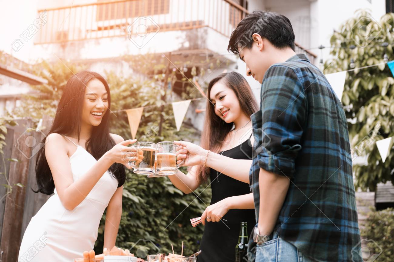 Asian Group Enjoying Toasting Drinks Party Weekend With Holding