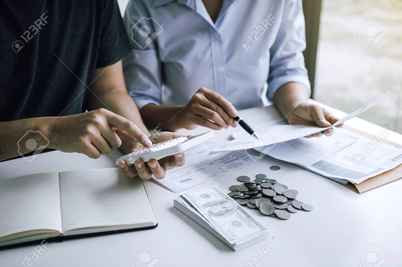 Two asian couples and men and women are together analyzing expenses or finances in deposit accounts and daily income sources with an savings economical concept. - 130112789