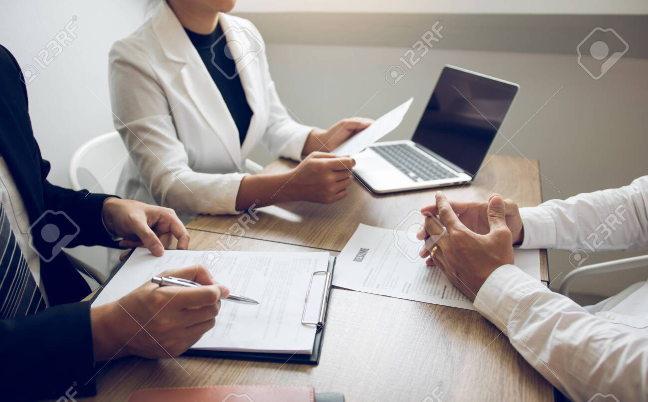 Serious asian businessman important conversation with male employee are reviewing resume documents. - 147501341