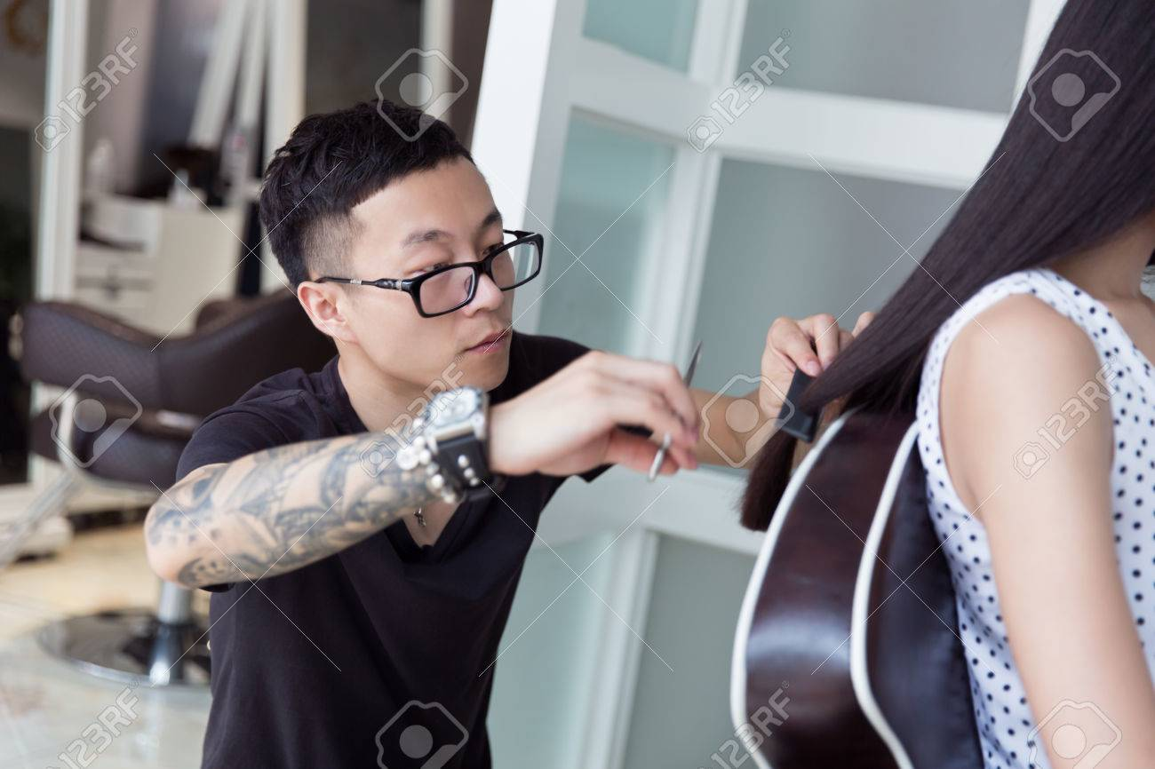 china professional hair stylist at a pretty girl trim long hair stock photo 59248139 - Professional Hair Stylist