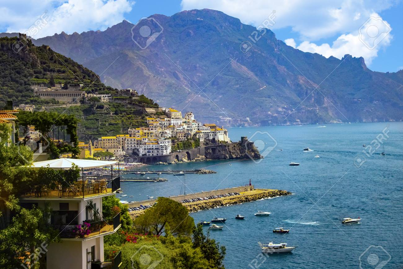 The view of Amalfi coast. This is on the south of Italy in Europe. The city stands on cliffs above the sea. There are boats on the sea. - 115679112