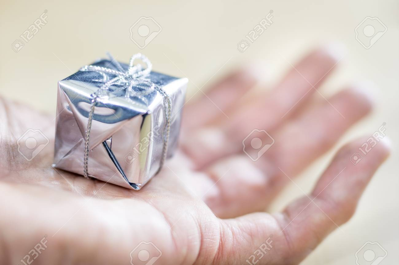 A Small Gift Packed On Male Hands. Decoration For A Christmas ...