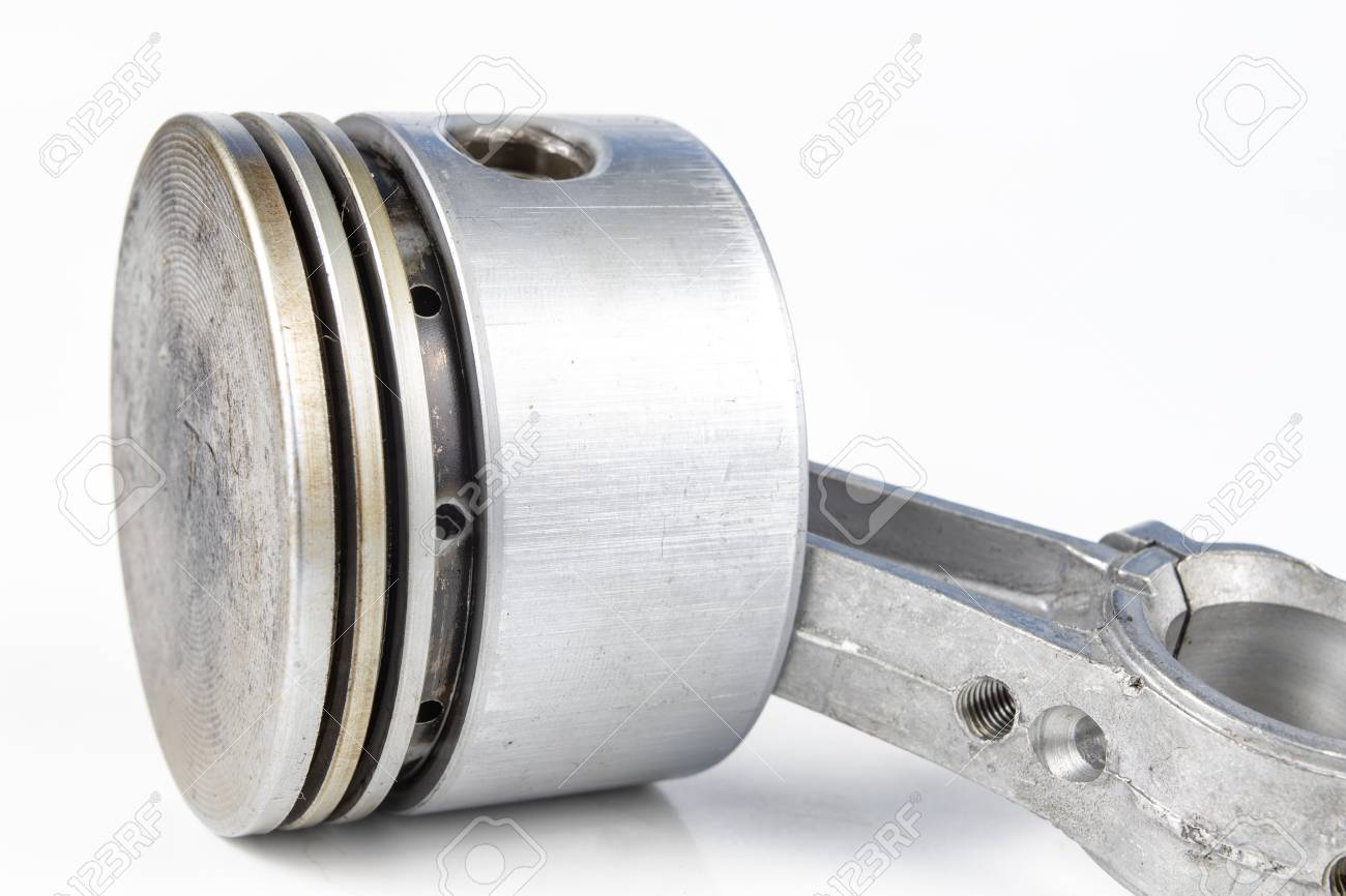 A Small Combustion Engine Piston On A White Table Spare Parts For