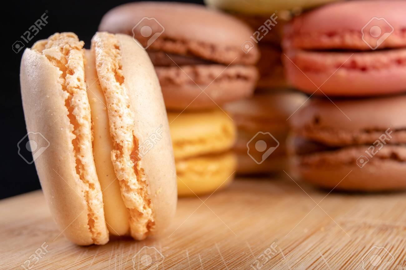 Tasty cookies on the kitchen table. Sweet dessert prepared to eat. Dark background. - 120424266