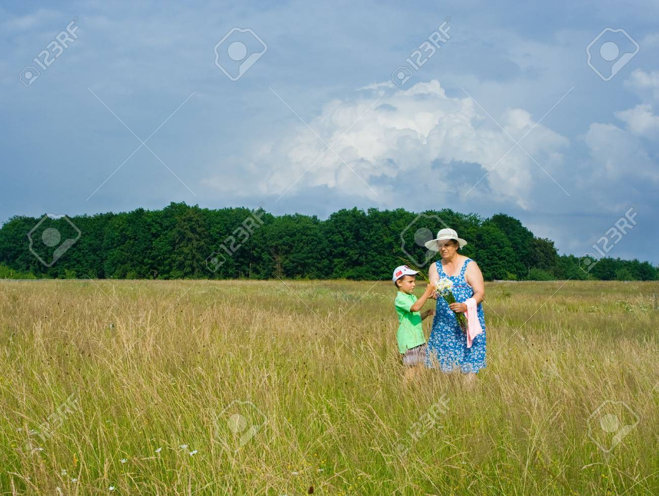Old woman and her grandson having a good time outdoor Stock Photo - 3250744