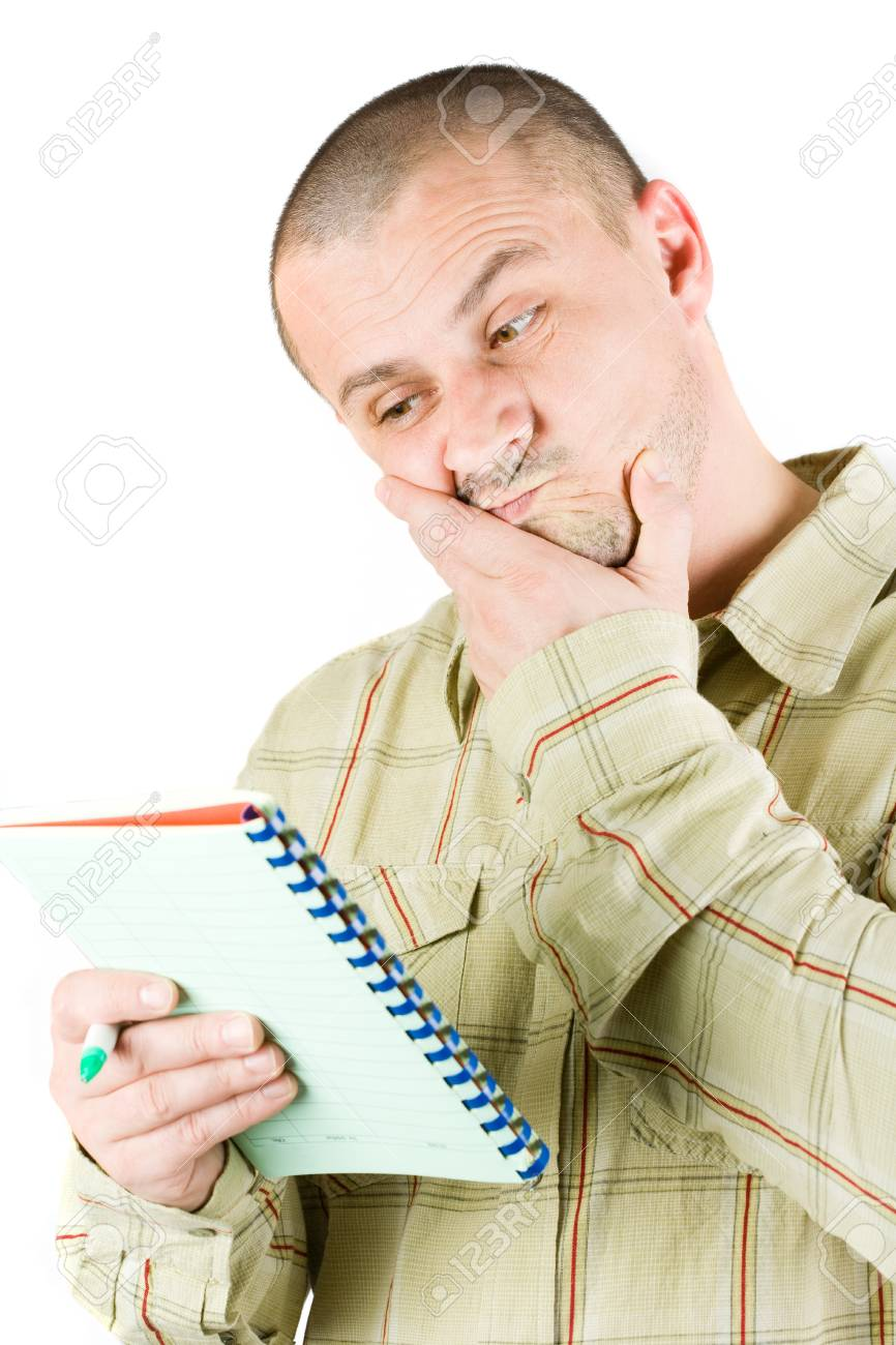 Worried businessman looking into a notebook Stock Photo - 4201352