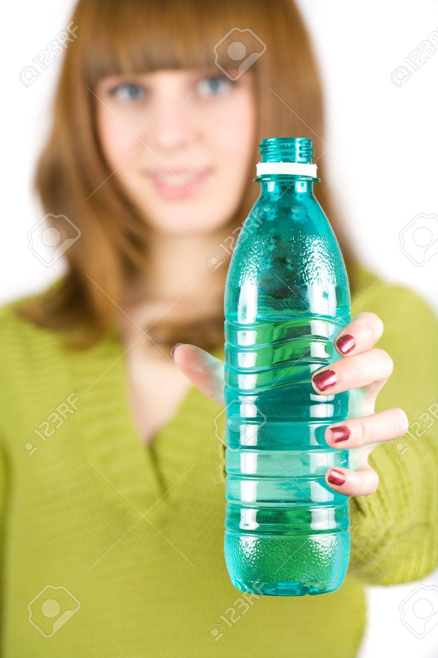 Portrait of an attractive blonde drinking water, isolated on white background Stock Photo - 4206961