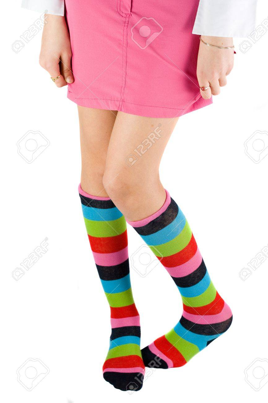 Schoolgirl legs with colored stockings, isolated on white background Stock Photo - 4569376