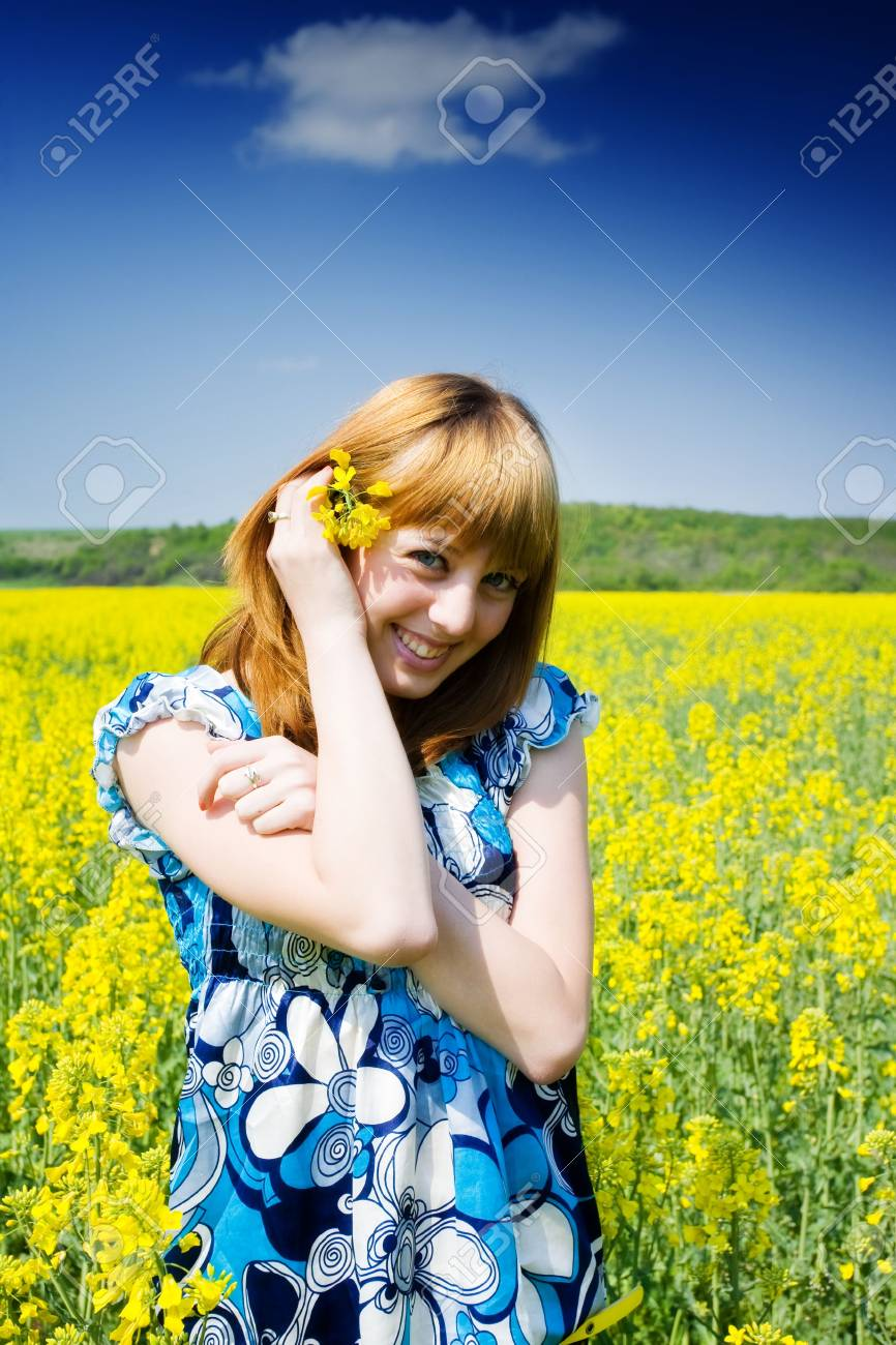 Pretty blonde in a rape field Stock Photo - 4819388