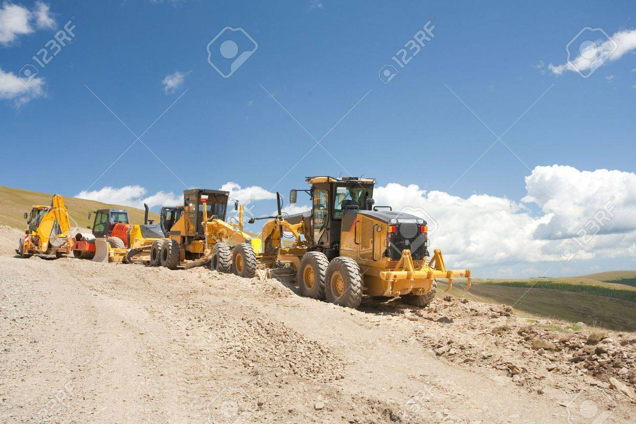 Excavators and construction machinery at a construction site outdoors Stock Photo - 5277870