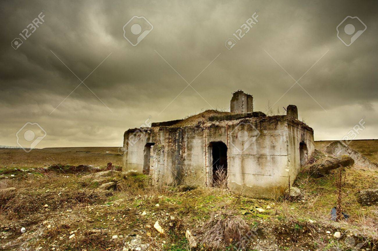 Landscape with a decrepit ruin of a building under moody sky Stock Photo - 6576145