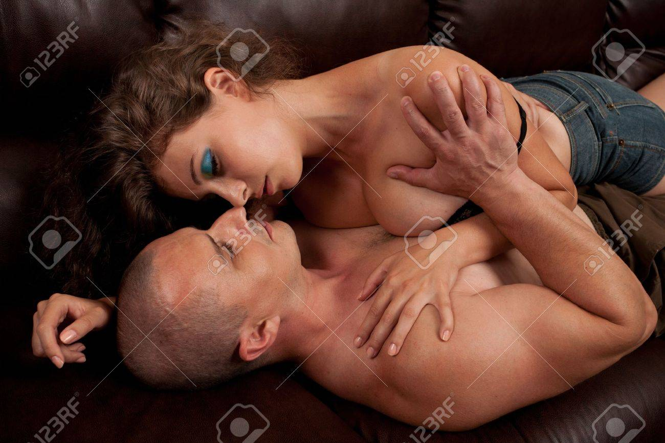 Young couple having an intimate moment on the couch Stock Photo - 7542081