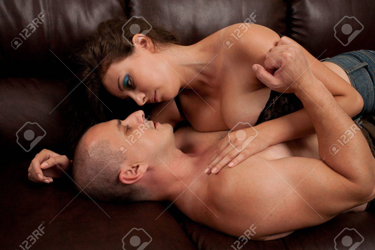 Young couple having an intimate moment on the couch Stock Photo - 7587846