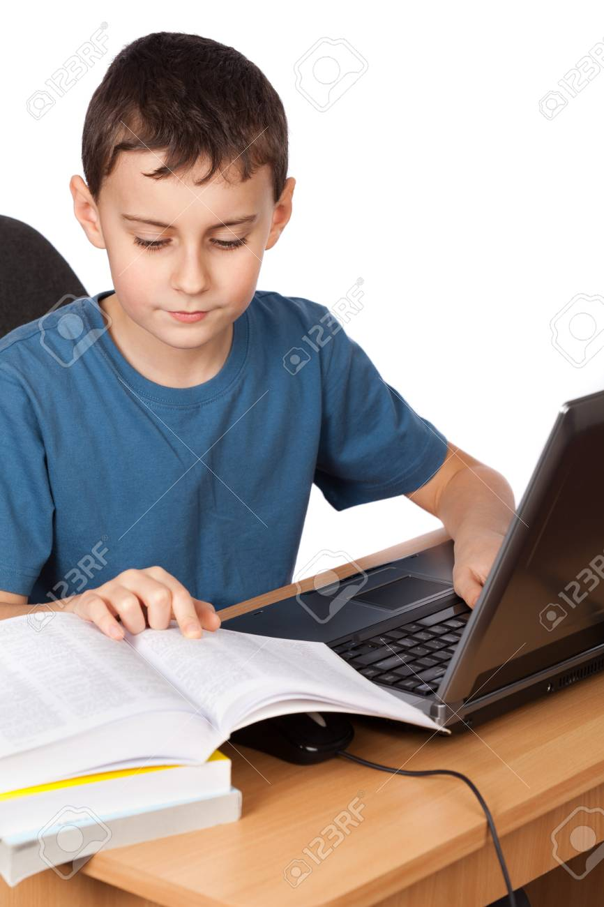 Portrait of a boy doing his homework at the laptop, isolated on white background Stock Photo - 9051320