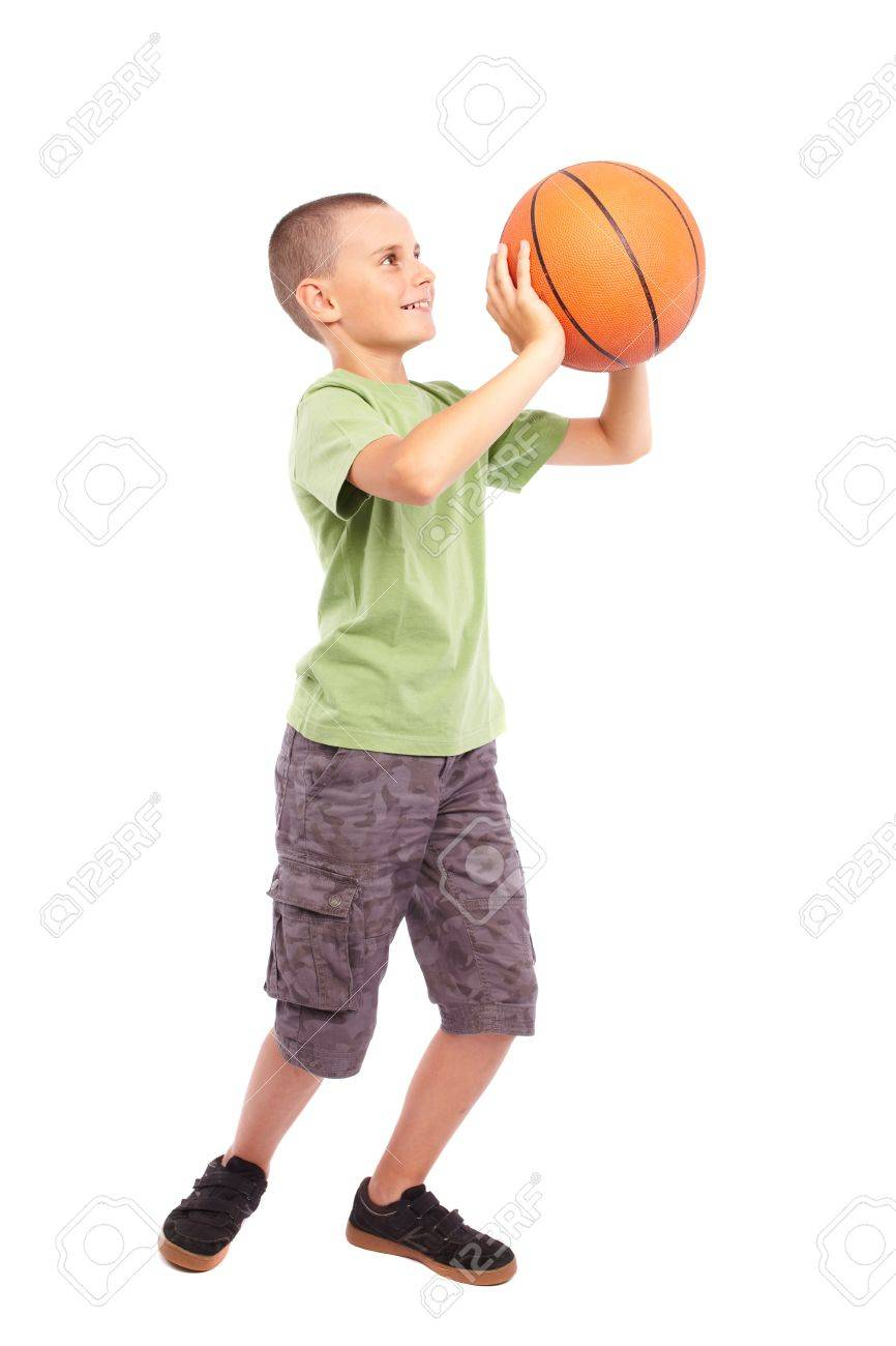 Caucasian Child playing basketball, isolated on white background Stock Photo - 10099525