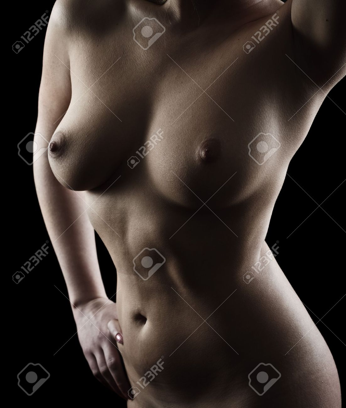 Nude body of a young woman isolated on black background Stock Photo - 11272010