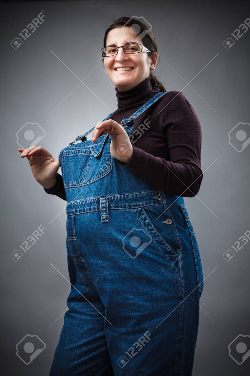 Studio portrait of a young pregnant woman Stock Photo - 12845920