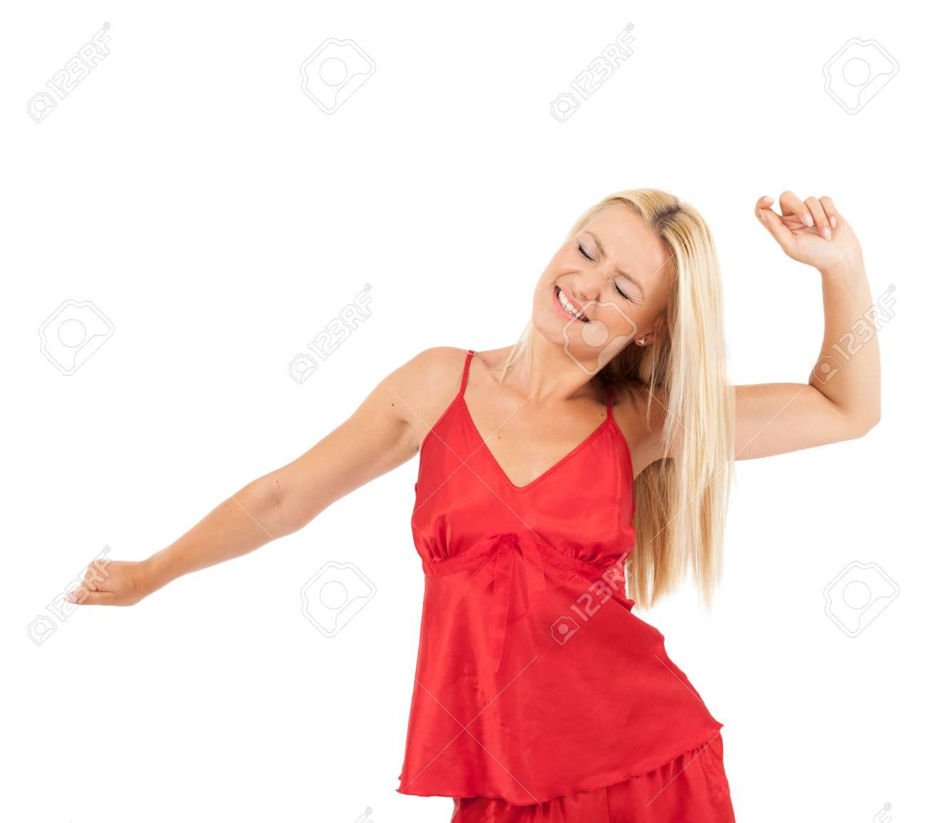 6b66230c0a Foto de archivo - Mujer joven en pijamas rojos sobre fondo blanco