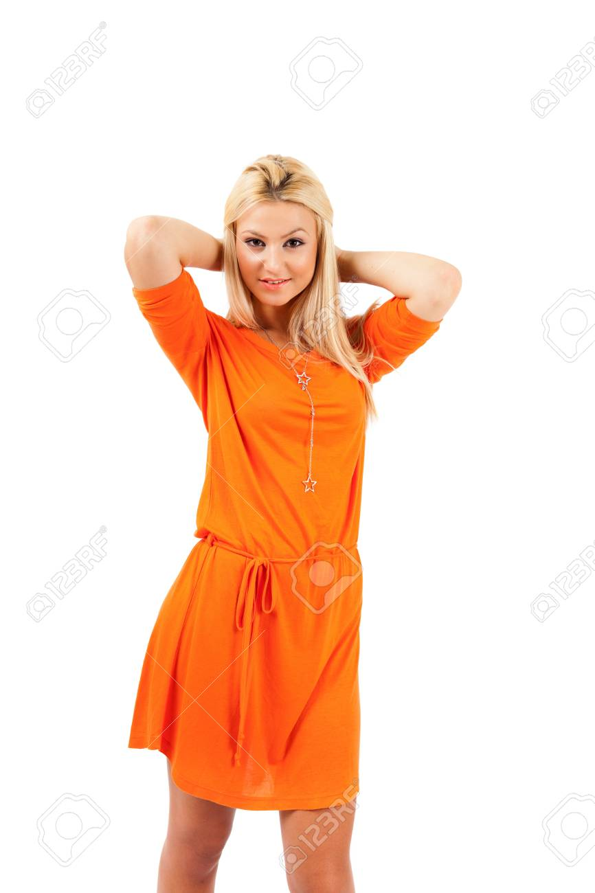 Young blond woman in orange dress over white background Stock Photo - 15609964