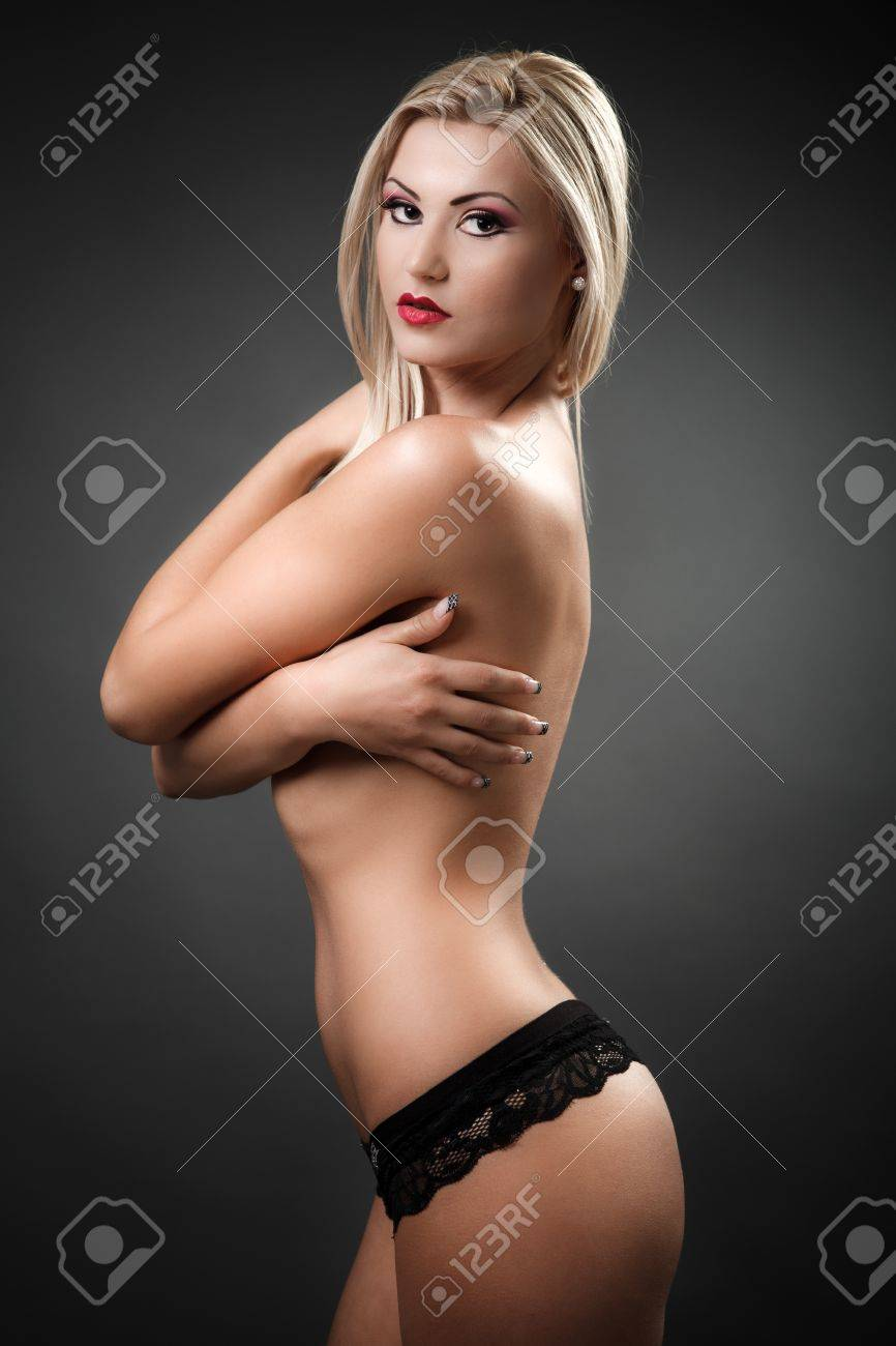 Portrait of a beautiful topless woman covering her breasts with her arms Stock Photo - 16324195