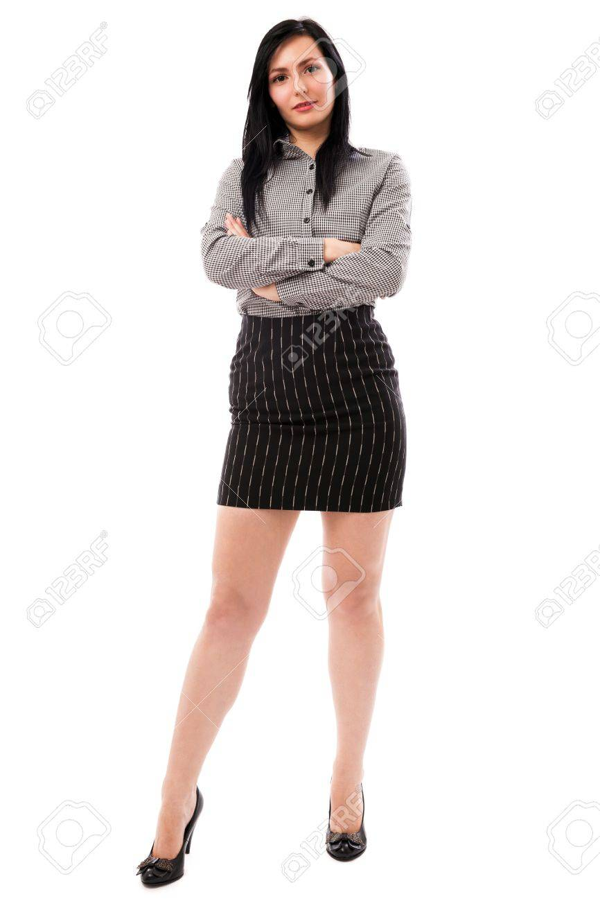 Full length portrait of a beautiful businesswoman standing with crossed arms isolated on white background Stock Photo - 16323952