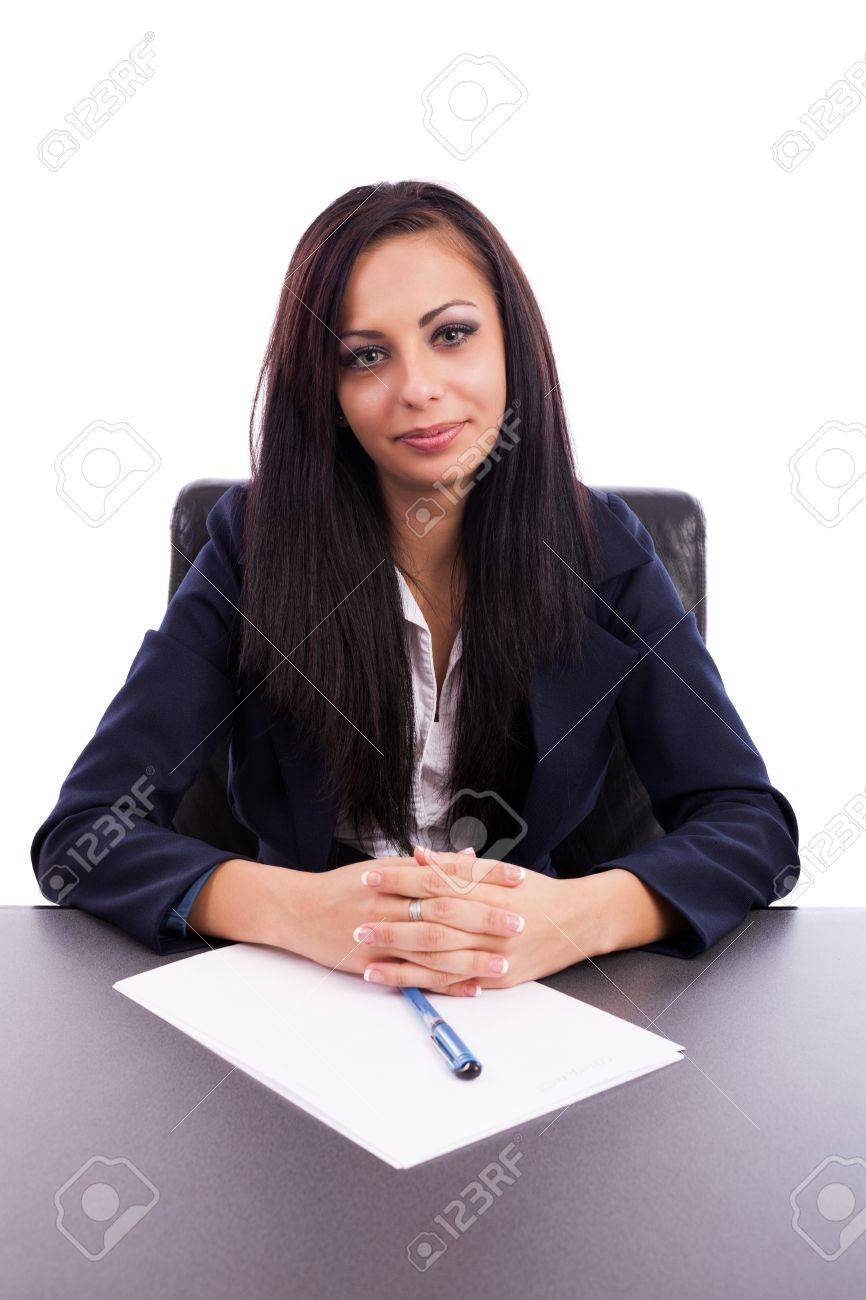 Closeup portrait of a beautiful latin businesswoman sitting at desk isolated on white background Stock Photo - 16324167