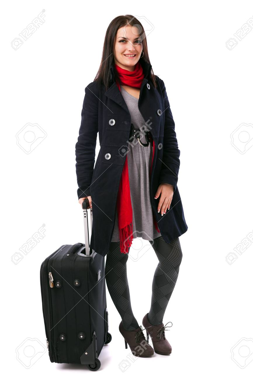 Full length portrait of a young woman holding a luggage isolated on white background Stock Photo - 16519554