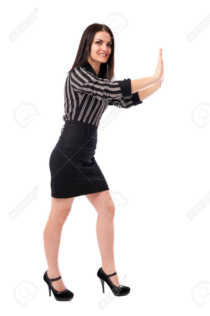 Full length portrait of a young businesswoman pushing an invisible large object isolated on white background Stock Photo - 16519557