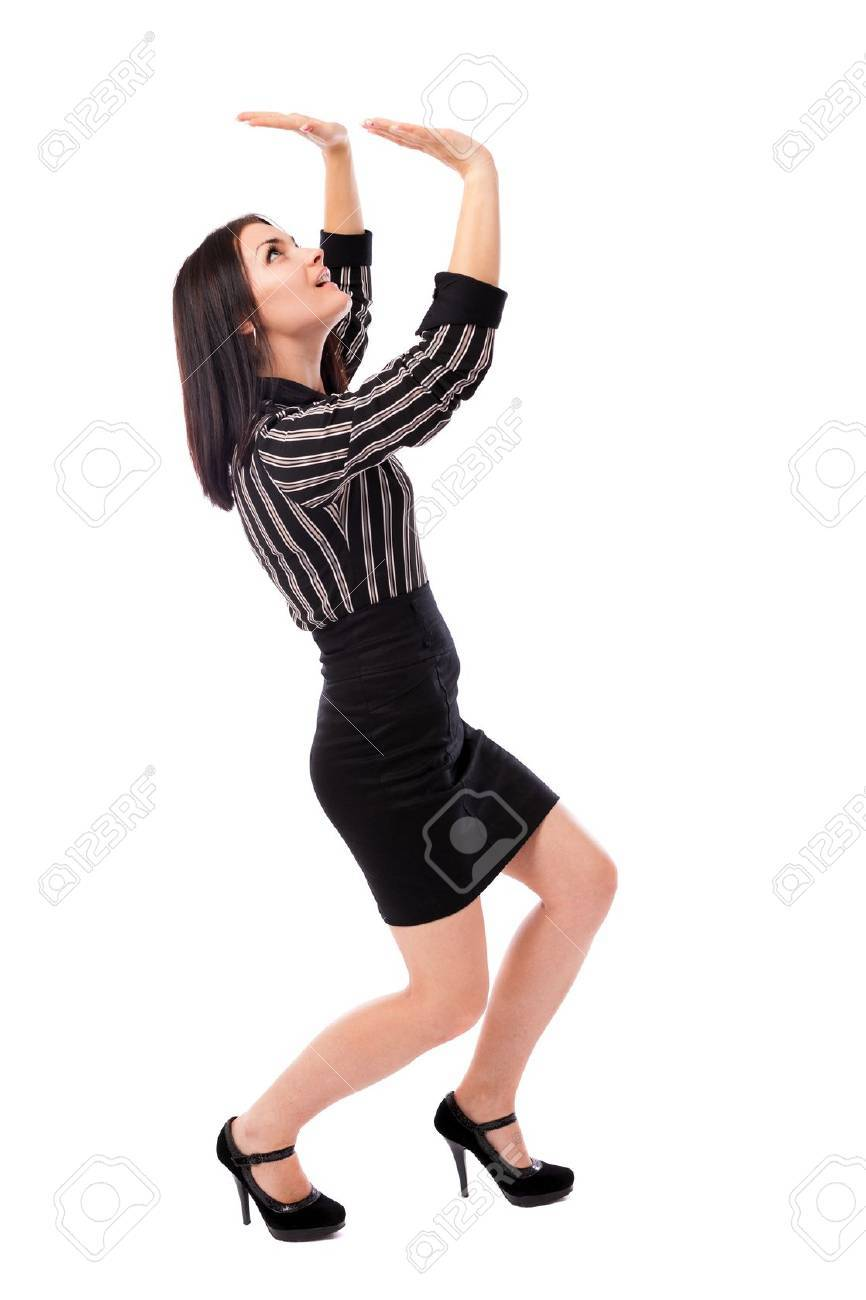 Full length portrait of a young businesswoman crushed by an invisible large object, insert your text or design above Stock Photo - 16519559