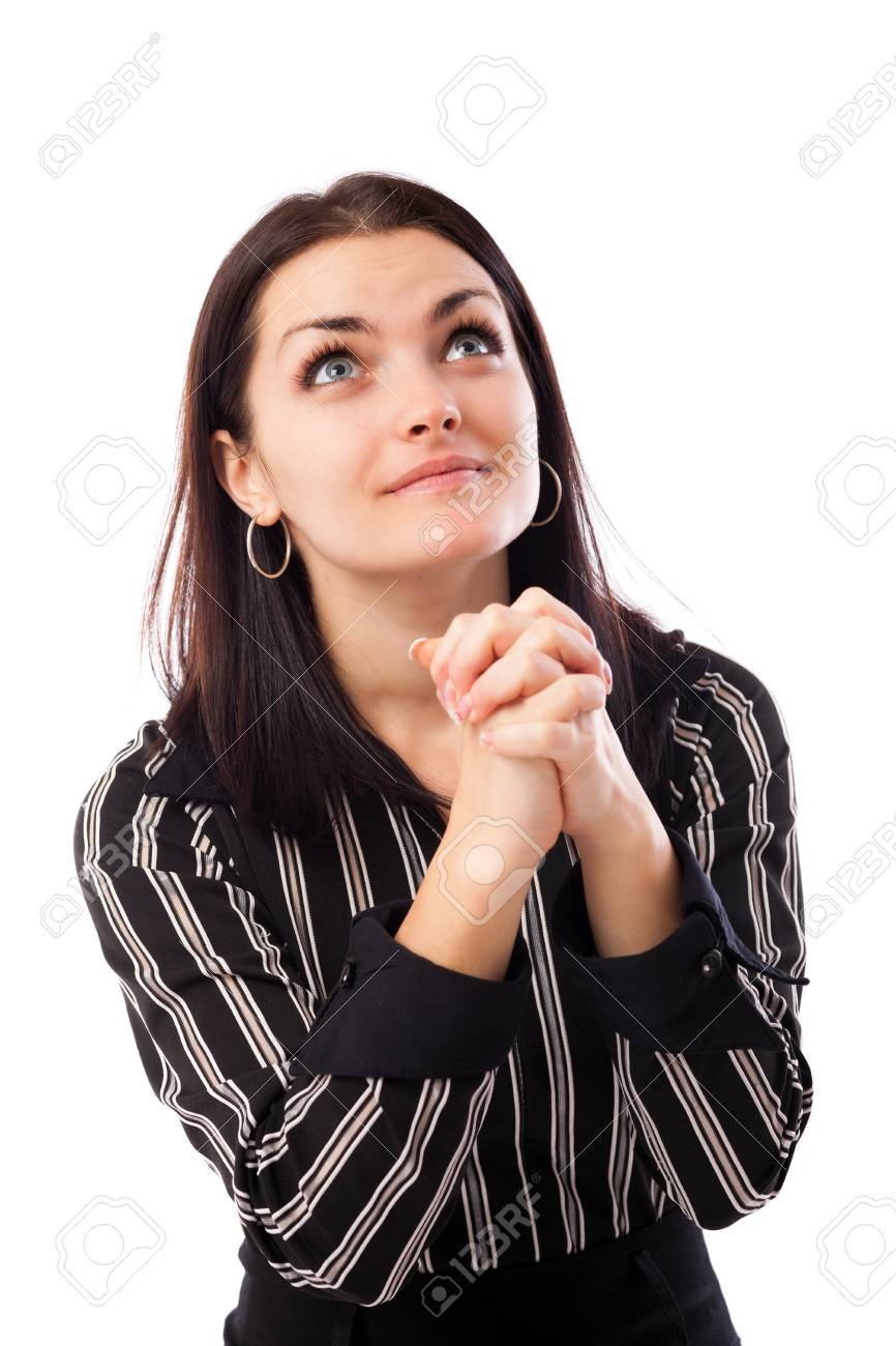 Closeup portrait of a young businesswoman praying while looking up Stock Photo - 16663431