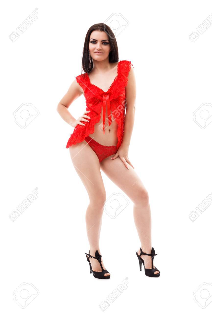 0a64ed4e0d Full length portrait of a beautiful young woman wearing red lace negligee  isolated on white background